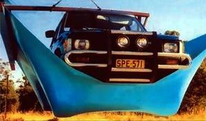 4WD car being held by pool liner