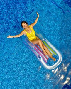 Woman Relaxing in a Pool on Floating Bed